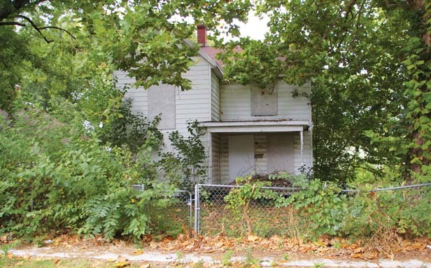 A vacant and boarded house on Springfield's east side, where consultants nine years ago recommended concentrated code enforcement. - PHOTO BY DAVID HINE