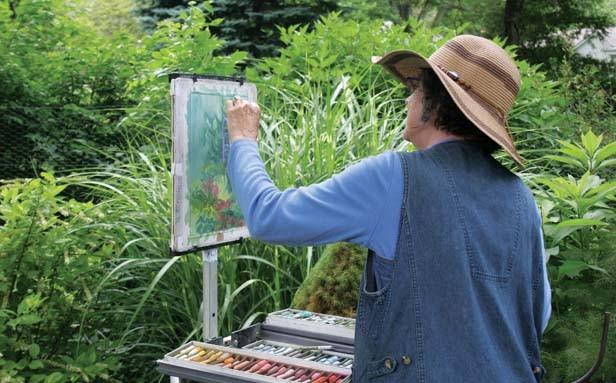 Sheri Ramsey, pastel artist, painting in the garden of Wanda Riseman. - PHOTO BY JOB CONGER