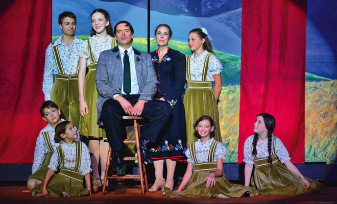 Captain Von Trapp (John O'Connor, center) surrounded by Maria and his seven children. - PHOTO BY DONNA LOUNSBERRY