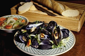 Moules mariniere, mussels steamed in white wine. - PHOTO BY NURI VALLBONA/TNS