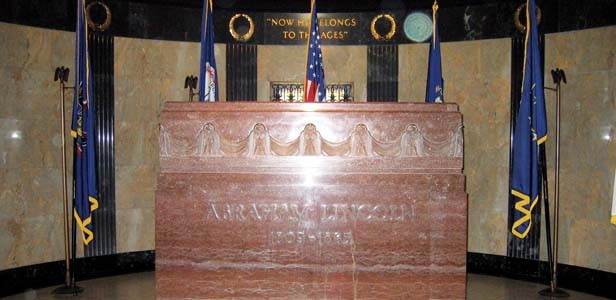"On the curving wall behind Abraham Lincoln's marble sarcophagus are the words attributed to Secretary of War Edward Stanton: ""Now he belongs to the ages."""