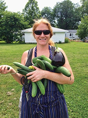 Ahsley Meyer showing off some of the produce from the garden. - PHOTO COURTESY ASHLEY MEYER