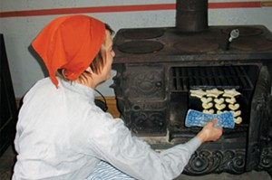 Christa Downing bakes cookies in preparation for the Bishop Hill Julmarknad (Christmas market), held  annually in the Swedish settlement in Henry County. This year's market will be Nov. 27-29 and Dec. 5-6. - PHOTO COURTESY OF BISHOP HILL STATE HISTORIC SITE