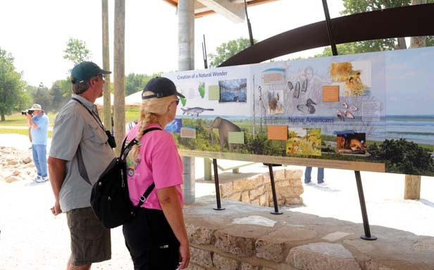 Interpretive signs tell the story of the site from prehistoric times to today's ongoing restoration efforts. - PHOTO BY THOMAS HANDY
