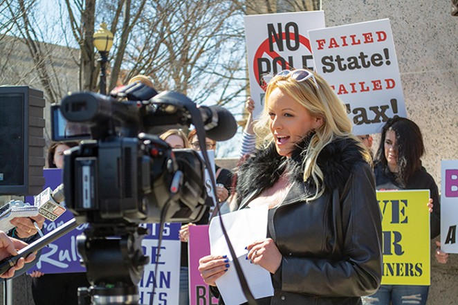 Adult film entertainer Stormy Daniels is pictured at an appearance at the Illinois State Capitol March 22. Daniels spoke for about two minutes, reading from prepared remarks against a six-year-old adult entertainment facilities tax, the proceeds of which - PHOTO BY JERRY NOWICKI, CAPITOL NEWS ILLINOIS
