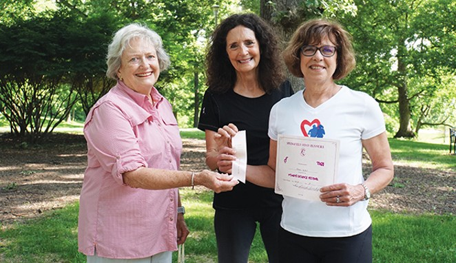 George Anne Daly, left, and Debbie Huffman, center, were codirectors of the first Women's Distance Festival. They're with Karen Witter, displaying her finisher's ribbon and certificate from the July 1980 race, signed by Daly and Huffm - PHOTO BY LEE MILNER