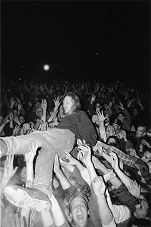 Hemenway crowd surfs during a performance in 1994. - PHOTO BY DARREN BALCH
