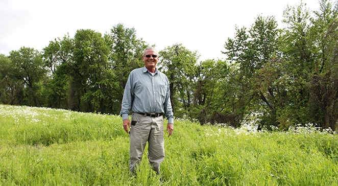 Larry Klein, who is on the Cairo port authority board and works with the local utility, stands next to the Mississippi River on land where they're hoping to build a port. The city owns this land but the public utility manages it. - PHOTOS BY MADELYN BECK