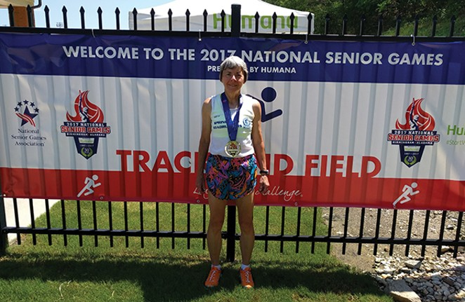 Becky Baum with one of three gold medals earned at the 2017 National  Senior Games in Birmingham, Alabama. - PHOTOS BY BECKY BAUM