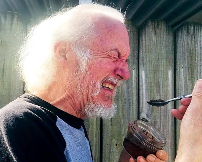 Peter Glatz sampling fermented grasshopper garum.