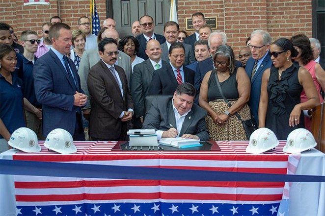 Gov. J.B. Pritzker has signed several bills aside from the more publicized ones he has been promoting, such as the capital infrastructure plan he is pictured signing. - PHOTO BY JERRY NOWICKI