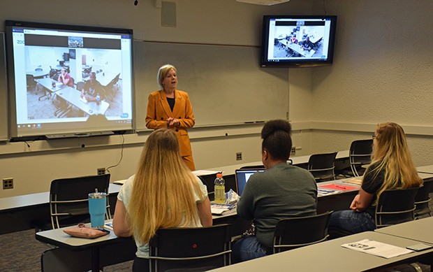 Professor Ronda Mitchell teaches a University of Illinois Springfield class that is creating a pathway for those currently working as para-professionals or classroom aides, or who are a few credits shy of completing a teaching degree. Students from Decatu - PHOTO BY DAVID BLANCHETTE