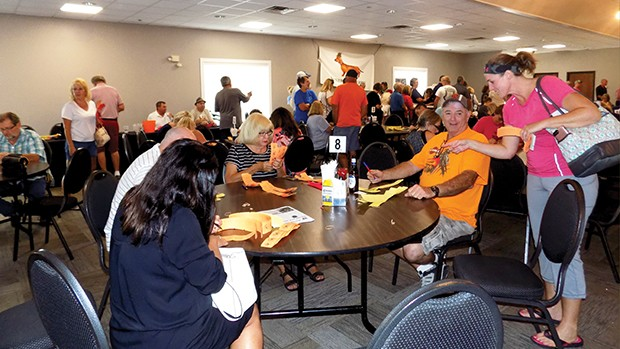 Bettors cram the Knights of Columbus to purchase raffle tickets. - PHOTO BY BRUCE RUSHTON
