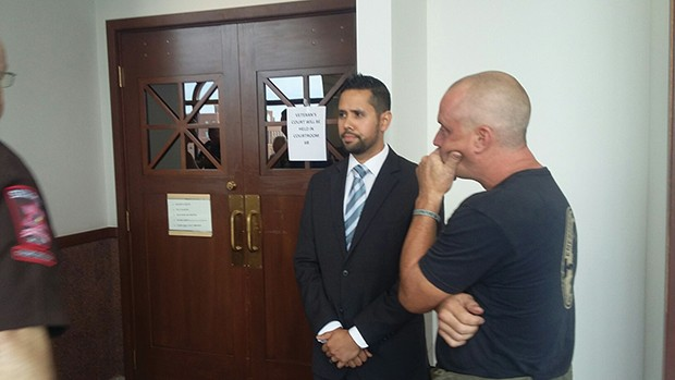 Rosario waits for the verdict outside the courtroom. - PHOTO BY BRUCE RUSHTON