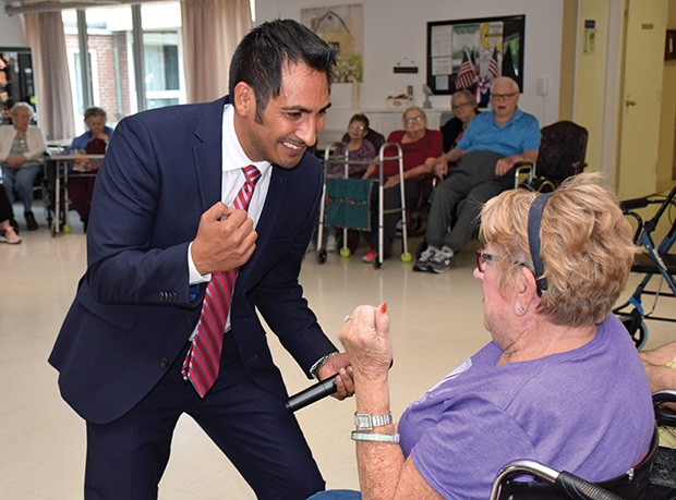 Barrenzuela engages in salsa dancing with Joann Morris, who was undergoing rehabilitation at Sunny Acres Therapy & Senior Services in Petersburg.