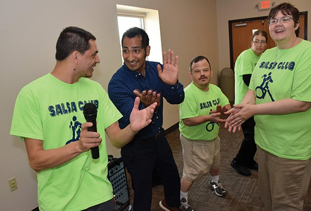 Salsa Club President Jesse Mattern, left, and  Barrenzuela lead a session at Pathway Services Unlimited in Jacksonville.