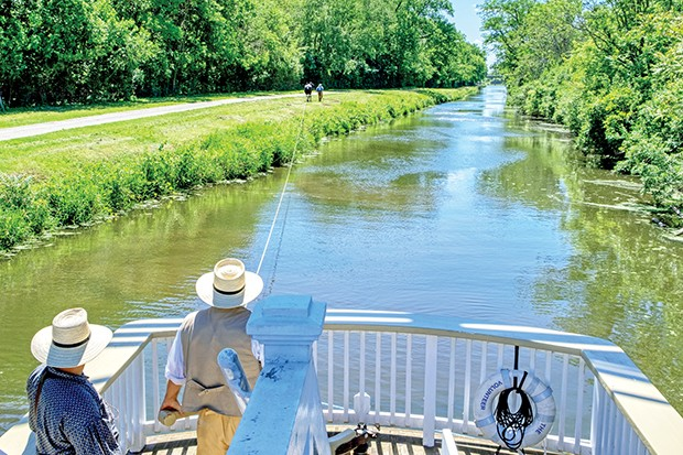 The Illinois and Michigan Canal became a National Heritage Area in 1984. Today, visitors can take an hour-long ride on a replica boat pulled by a mule and hear the canal's history from costumed guides. - PHOTO BY RANDY VON LISKI