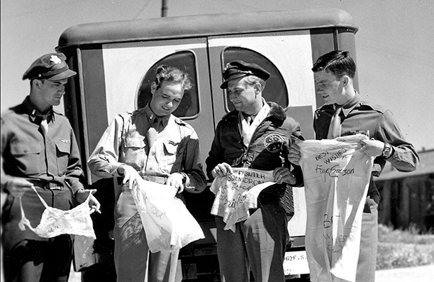 Members of Hagan's squadron with lingerie sent by Hollywood starlets. - PHOTO COURTESY OF THE ABRAHAM LINCOLN PRESIDENTIAL LIBRARY AND MUSEUM