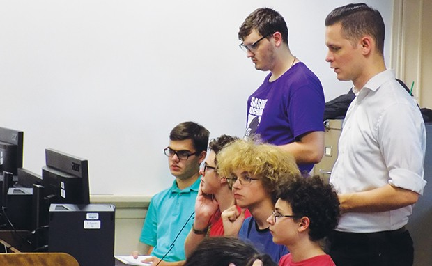 Esports coach Dalton McGhiey, standing in white shirt, oversees tryouts for the Springfield Capitols. - PHOTO BY BRUCE RUSHTON