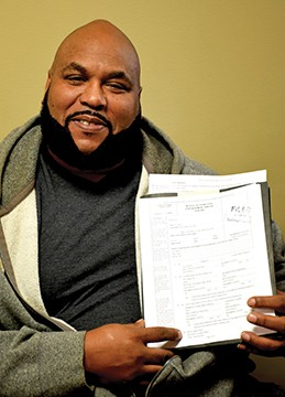 Willie Lucas shows the petition he hopes will put his past behind him. - PHOTO BY DAVID BLANCHETTE