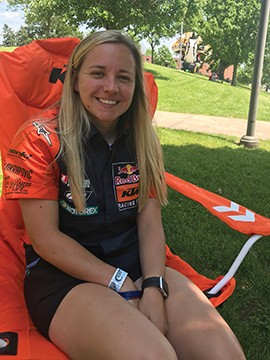 Shayna Texter seated in her factory sponsor KTM lawn chair. P - HOTO COURTESY LARRY EVANS PHOTOGRAPHY