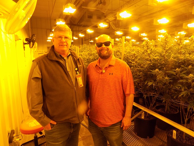 The future of the pot business is so bright that TIm O'Hern, right, wears shades while his father Larry O'Hern compares growing weed to traditional agriculture. - PHOTO BY BRUCE RUSHTON.