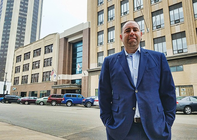 Chris Stone, who owns a seven-story building that was once a department store, says the city needs to make things easier for downtown developers. - PHOTO BY DAVID HINE