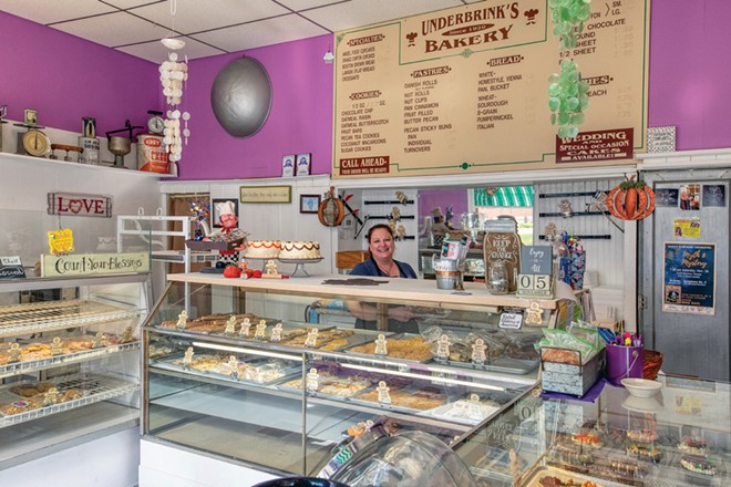 Owner Amy Stevens presides over Underbrink's Bakery in Quincy, which was recently named the top bakery in Illinois. The bakery has operated from the same spot since 1929 and offers a multitude of goodies, including its signature iced angel food cupcakes. - PHOTO BY RANDY VON LISKI