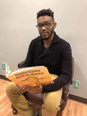 Author Lamar Walls at The Rainbow Room's monthly kids' storytime session. - PHOTO COURTESY THE RAINBOW ROOM
