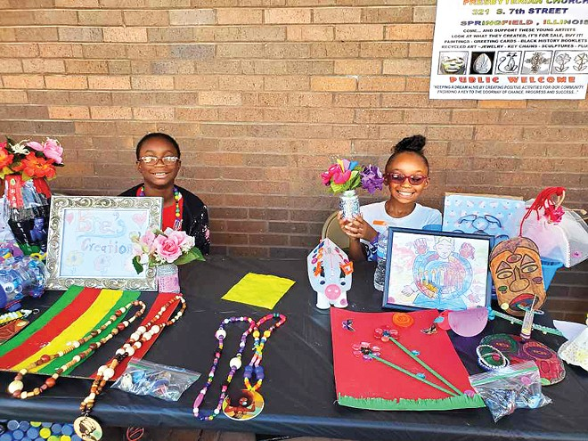 Gabby Reeves (left) and Camya Burnes selling their art. - PHOTO COURTESY OF GARVEY-TUBMAN CENTER