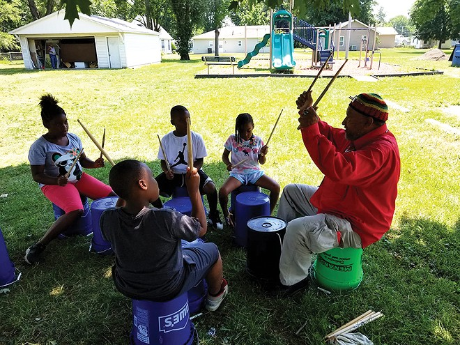 Crisp drumming with children. - PHOTO COURTESY OF GARVEY-TUBMAN CENTER