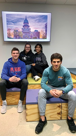 From left, Joel Niermann, Hannah Matrisch, Avia Wang and Kasra Nassirpour are Sangamon CEO students, who completed a survey and study of downtown parking. - CREDIT MARY HANSEN / NPR ILLINOIS