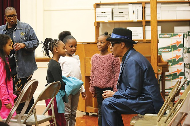 James Armstrong plays and talks music and culture with a group of students at Dubois Elementary School in Springfield. - PHOTO COURTESY MICHAEL GOZA / ILLINOIS CENTRAL BLUES CLUB