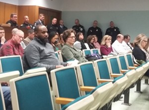 Springfield police officers watch as aldermen talk about carbon monoxide at Tuesday's city council meeting. - PHOTO BY BRUCE RUSHTON