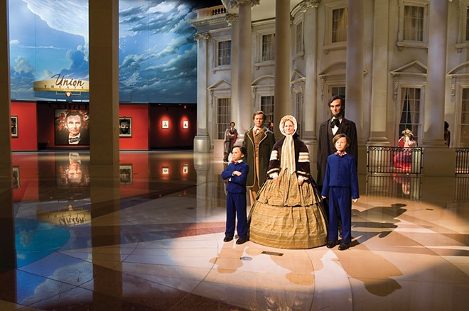 The president and his family greet visitors in the museum's entry - plaza, with a replica of the White House in the background. - PHOTO E. JASON WAMBSGANS
