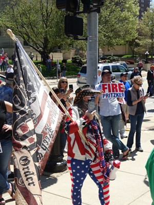 "A group calling itself ""Re-open Illinois"" organized an unpermitted rally held outside the Statehouse. - PETER HANCOCK, CAPITOL NEWS ILLINOIS"
