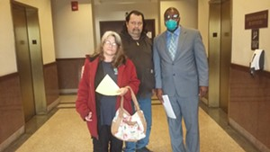 Rick and Carla Phelan with their lawyer Dowin Coffy. - PHOTO BY BRUCE RUSHTON