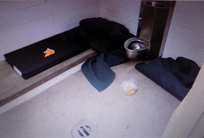 Rusher spent four months in solitary confinement in a Sangamon County jail cell the size of a small bathroom.
