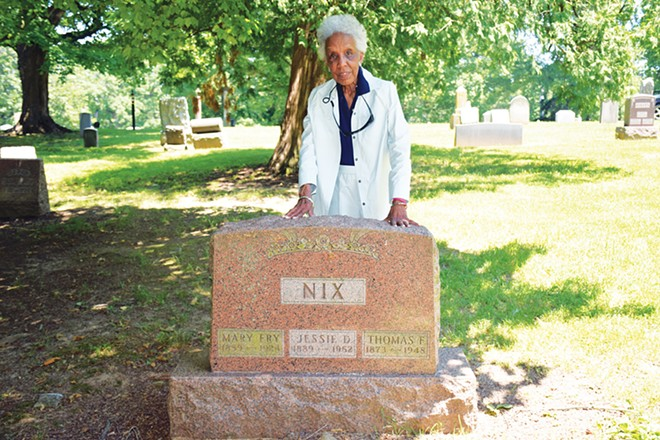 Theresa Faith Cummings by the grave of ancestors Mary Fry, Jessie Nix and Thomas Nix in the Colored Section of Oak Ridge Cemetery. - PHOTO BY DAVID BLANCHETTE