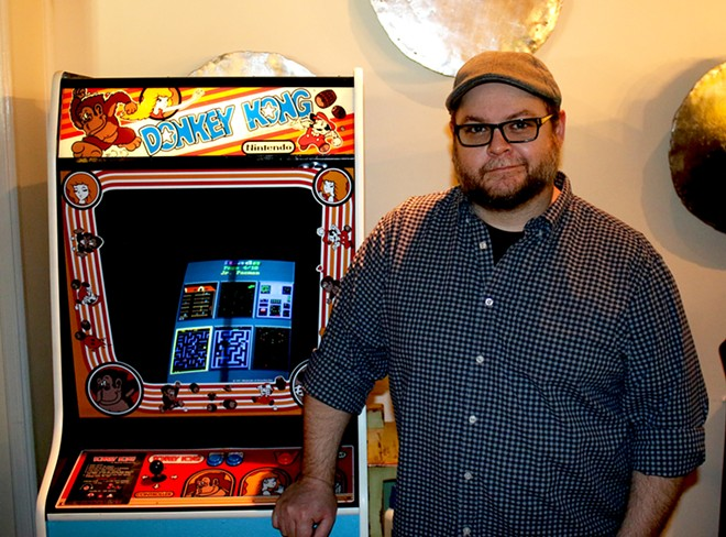 Arlington's owner, Ebben Moore, said he is an arcade geek and incorporating the games into his business was a natural fit. - PHOTO BY BRANDON TURLEY