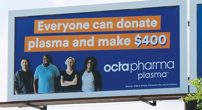 A billboard at 11th Street and South Grand Avenue touts how much money an individual can make by donating plasma. - PHOTO BY STACIE LEWIS
