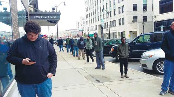 LInes are common outside Illinois pot dispensaries, where nearly $240 million worth of pot and cannabis products were sold  during the first six months of this year despite shortages. - PHOTO BY BRUCE RUSHTON