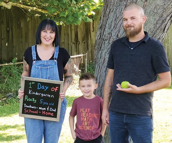 Kelsey and Nick Pedigo will be teachers for their son Rocky this year, as they chose not to enroll him in school. - CREDIT: RACHEL OTWELL