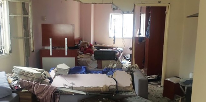 The same living room from the same angle after the Aug. 4 explosion that killed Zeina.
