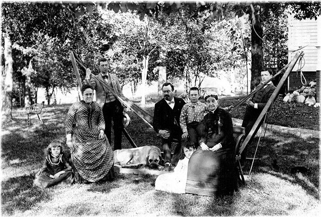 The Colonel Noble Bates Wiggins family in front of the Leland house, around 1886. - COURTESY SANGAMON VALLEY COLLECTION, LINCOLN LIBRARY