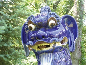 One of 22 blue porcelain fu dogs greets visitors to one of 14 formal gardens at Allerton Park, a few miles outside Monticello. Robert Allerton traveled the world collecting sculptures to add to his estate. - PHOTO BY BRENT BOHLEN