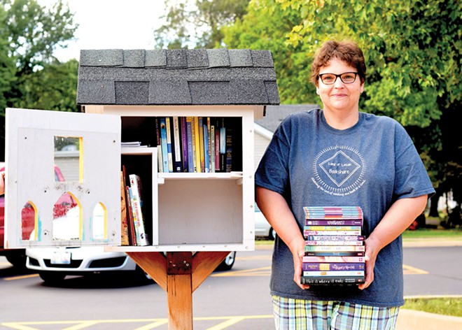 Tina Carnes is one of the founders of Land of Lincoln Bookshare, a nonprofit that provides free books for children and adults through Little Free Libraries and other venues. - PHOTO BY NORMA ZUNIGA