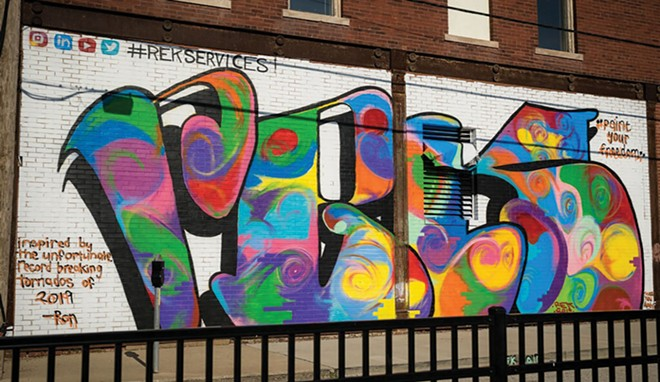Ron's first major public mural, painted June 2019 on Third Street in downtown Springfield. Features his initials with colorful swirls inspired by the May 2019 Illinois tornado outbreak.
