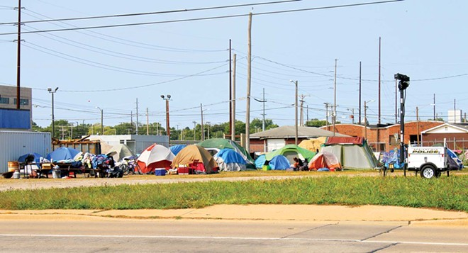 Approximately 50 homeless people have created Tent City behind the City of Springfield's Warming/Cooling Center at 1015 E. Madison St. Volunteers come every day to provide meals and supplies. - PHOTO BY BRANDON TURLEY