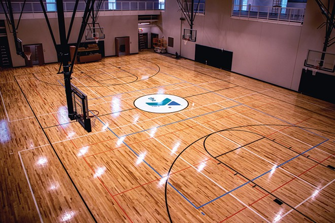 The large gym, with multiple basketball goals, is equipped for use as volleyball, pickleball and badminton courts as well. - PHOTO BY ZACH ADAMS